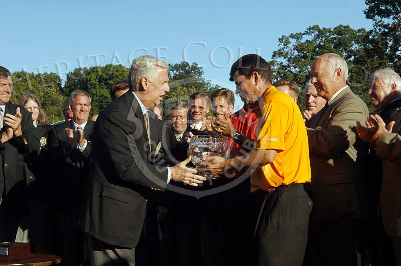 PGA of America President Roger Warren presenting the trophy to the Low Club Professional Don Yrene during round 4 of the 88th PGA Championship in Medinah, Illinois. Sunday, August 20, 2006.