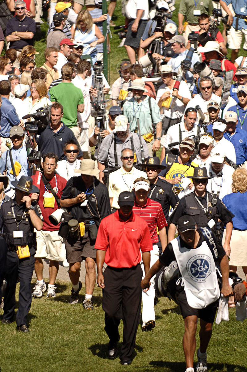 A confident Tiger Woods walking from No. 8 with the gallery following during round 4 of the 88th PGA Championship in Medinah, Illinois. Sunday, August 20, 2006. Photographer: Montana Pritchard