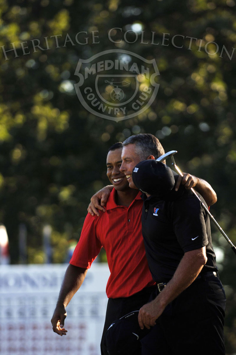 Tiger Woods hugging his caddie, Steve Williams, after making his putt to win on No. 18 green during round 4 of the 88th PGA Championship in Medinah, Illinois. Sunday, August 20, 2006. Photographer: Montana Pritchard