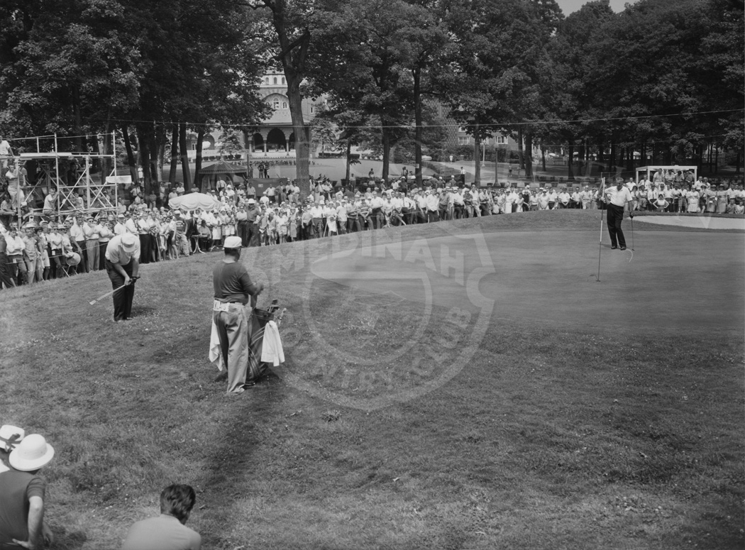 Jack Nicklaus chipping onto the 18th green during the 1962 Western Open. Medinah Country Club clubhouse in background Sun-Times photo, 6/28/1962.