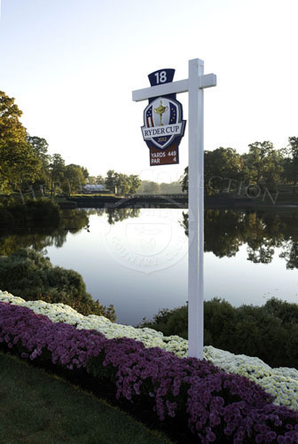 Tee box signage for 18th hole, with Lake Kadijah in background.
