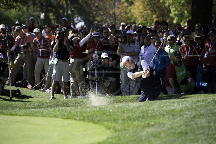 Justin Rose spins one out of the bunker on the 11th hole.