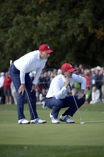 Teammates Snedeker and Furyk take a close look at their birdie putt during Friday's matches.