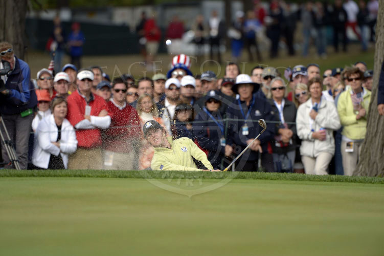 McIlroy splashes his shot out of the bunker during the matches on Friday.