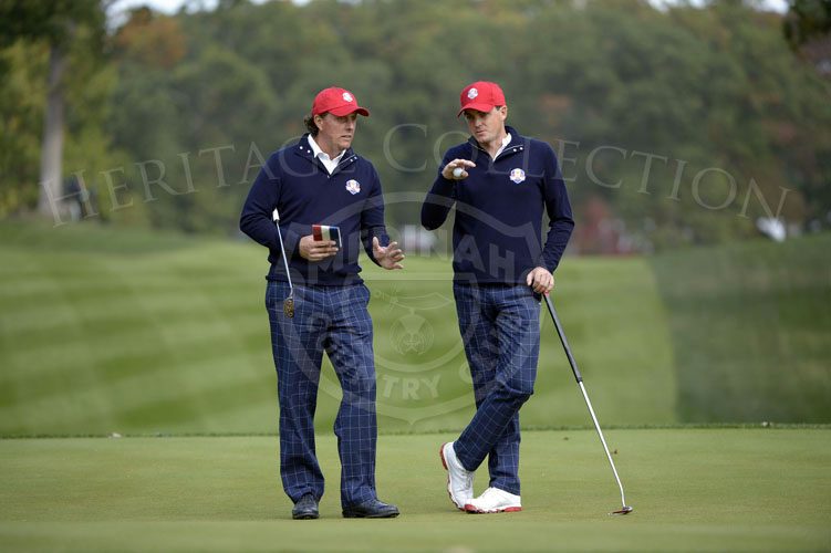 Mickelson and Bradley discuss the slope of the 14th green during Fridays matches.