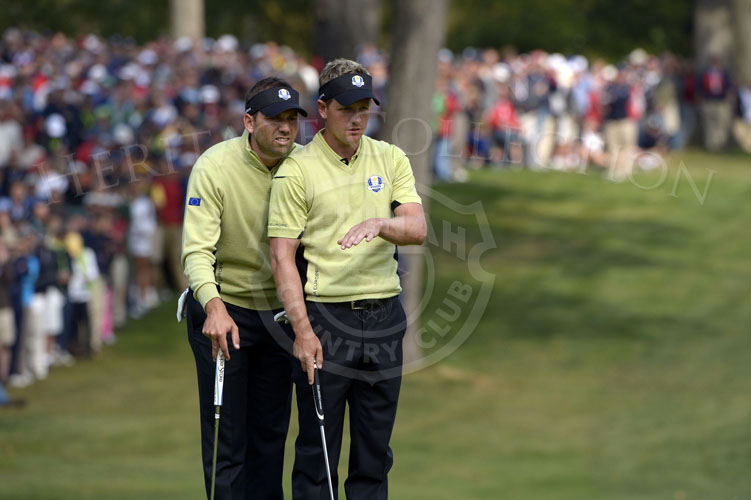 Teammates Garcia and Donald review their birdie putt on the 14th hole of Friday's matches.