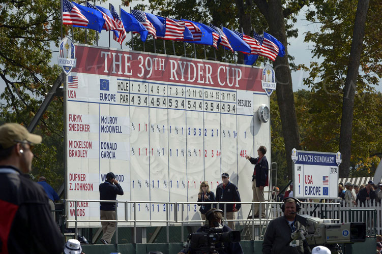 Scenic image of the 18th hole scoreboard at the beginning of matches on Friday.