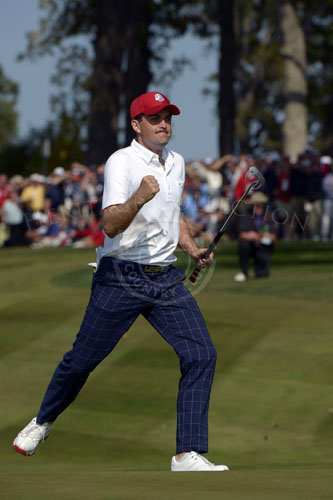 Bradley sinks his putt for birdie, gives the erupting crowd a fist pump!