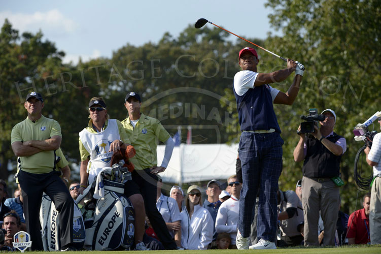 Woods tee shot on the 9th hole, as opponents Westwood and Colsaerts look on.