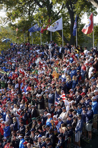 Crowds in stands at the 1st tee early Saturday morning.