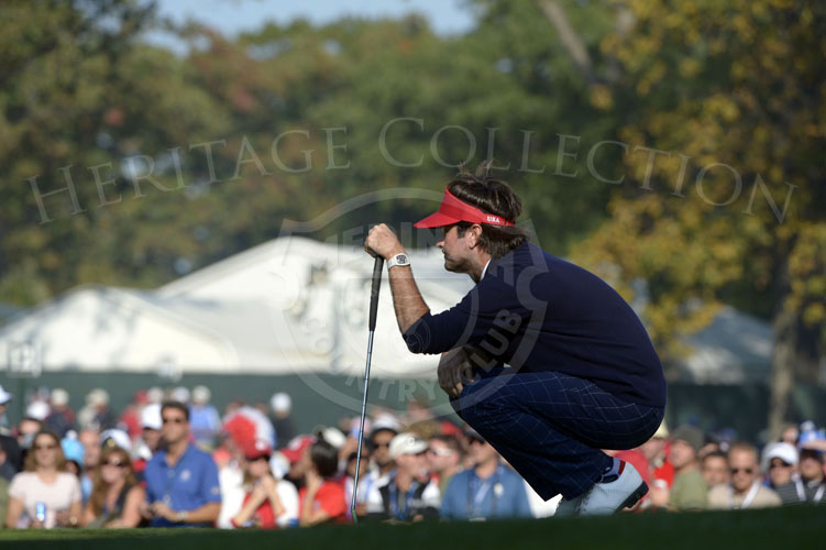 Watson surveying his putt on the 14th green on Saturday.