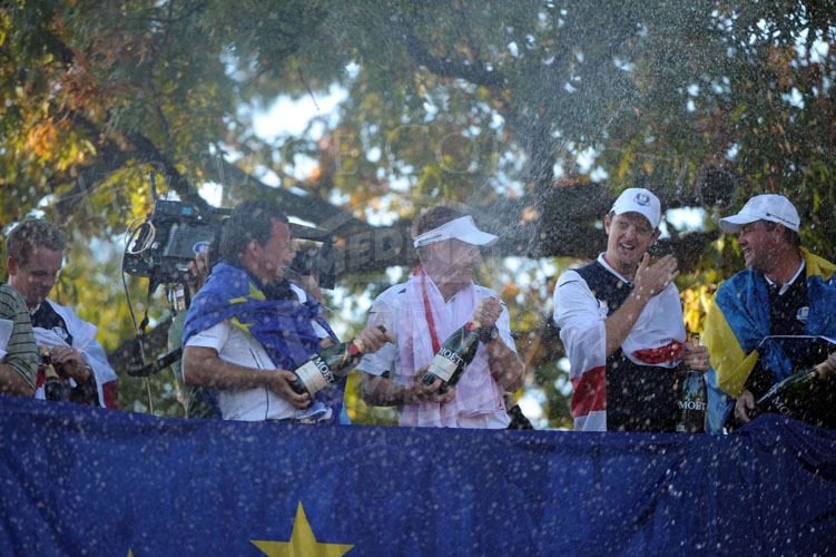 Team Europe douses the crowd and each other with champagne after the matches!