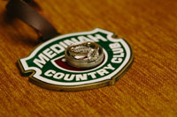 Medinah Country Club logo underneath a wedding ring